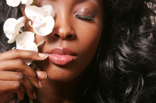 Beautiful sexy black woman with orchid